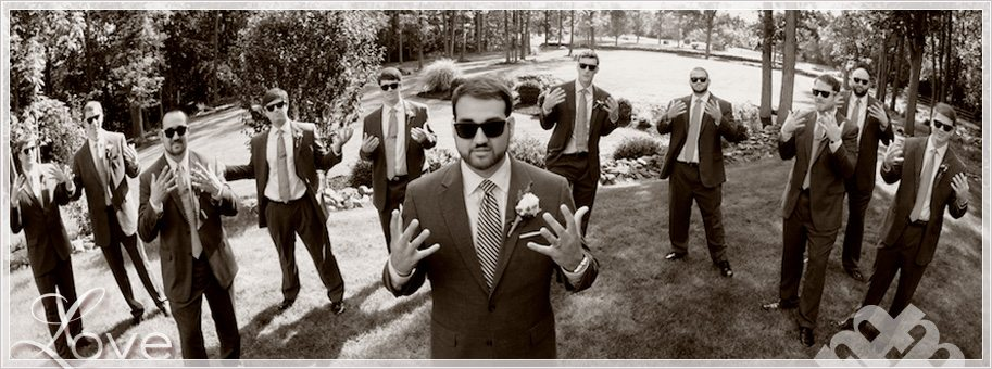 unique Groomsmen photos with large bridal party wearing sunglasses