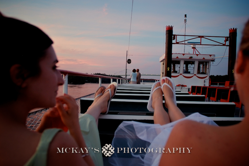 photo-journalist wedding photo on the Alexandria Belle boat tour at sunset