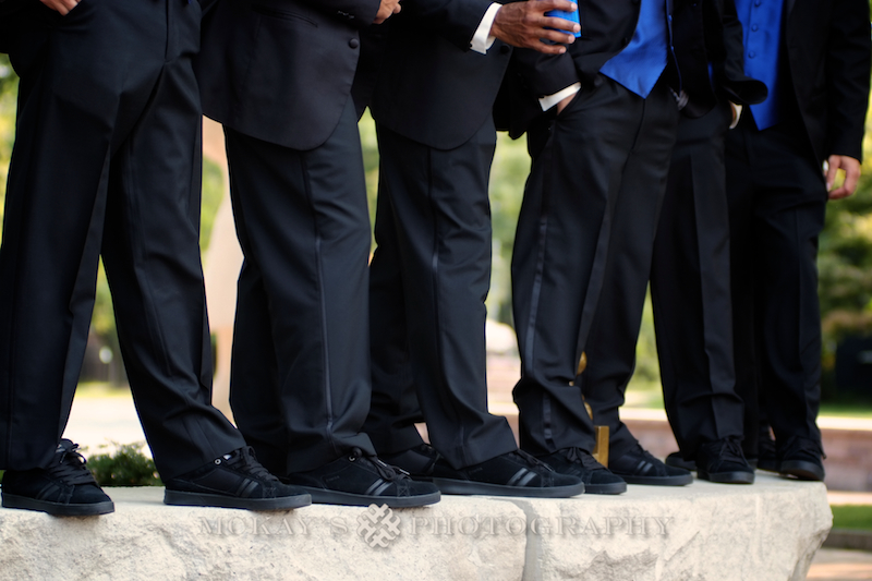 Aaron Costa of Krudco Skateshop with black skate shoes at a wedding by top Rochester Wedding Photographer Heather McKay