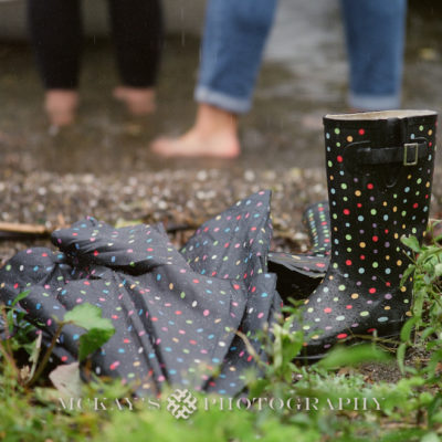 rainy engagement pictures on Keuka Lake with Lesbian wedding couple