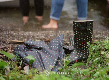 rainy engagement pictures on Keuka Lake with Lesbian wedding couple