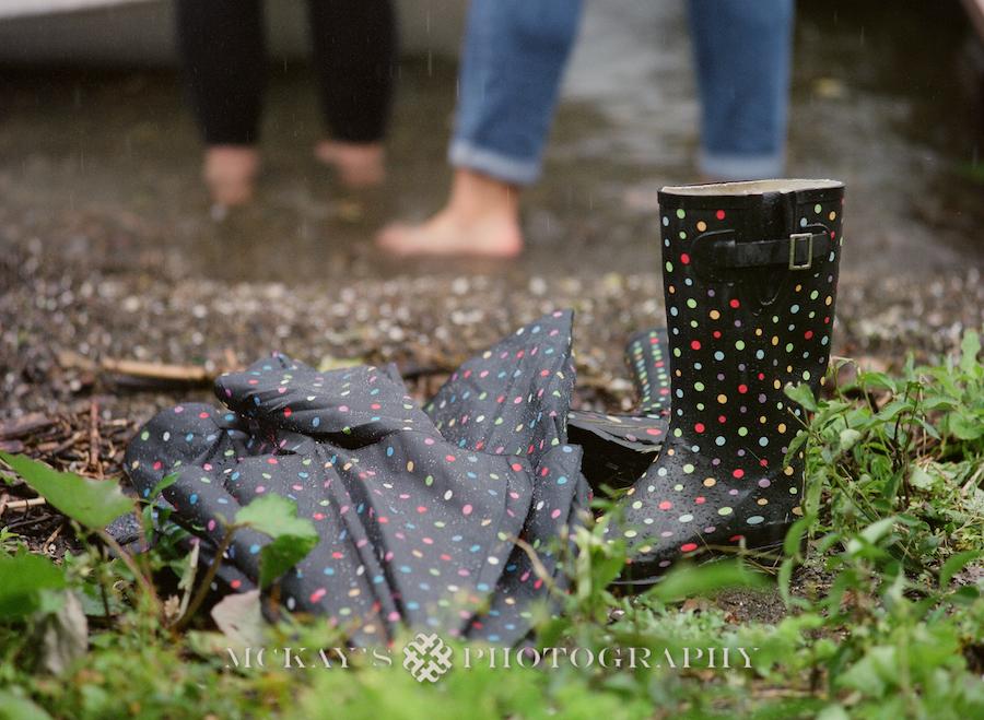 rainy lesbian engagement photos on Keuka Lake by fine-art wedding photographer Heather McKay