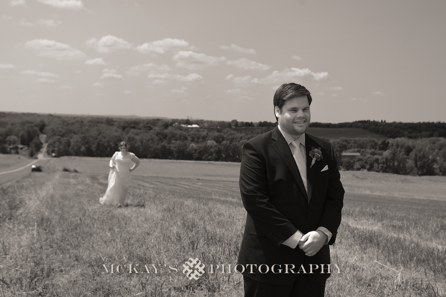 first look wedding photos in a field