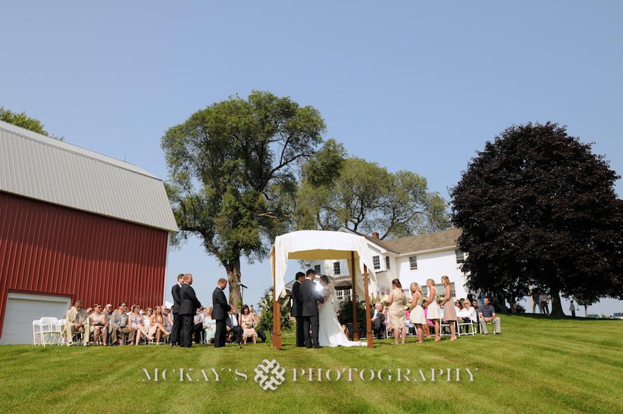 Rustic Farm Wedding Photos with ferris wheel at wedding near Rochester NY