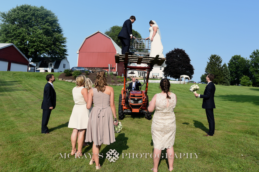 fun tractor farm wedding photos for bridal party pictures