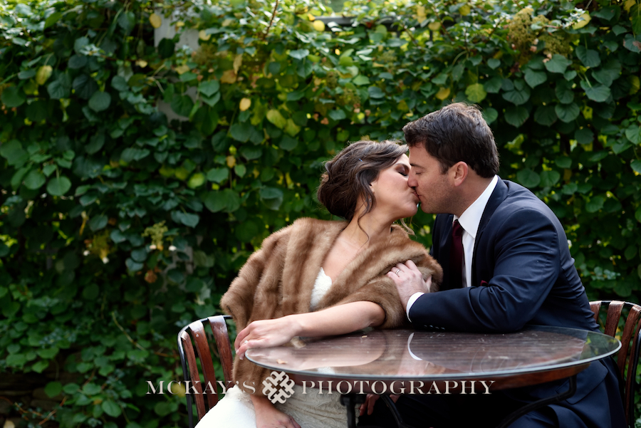 Bride wearing vintage fur wrap on her wedding day lakeside in the Finger Lakes