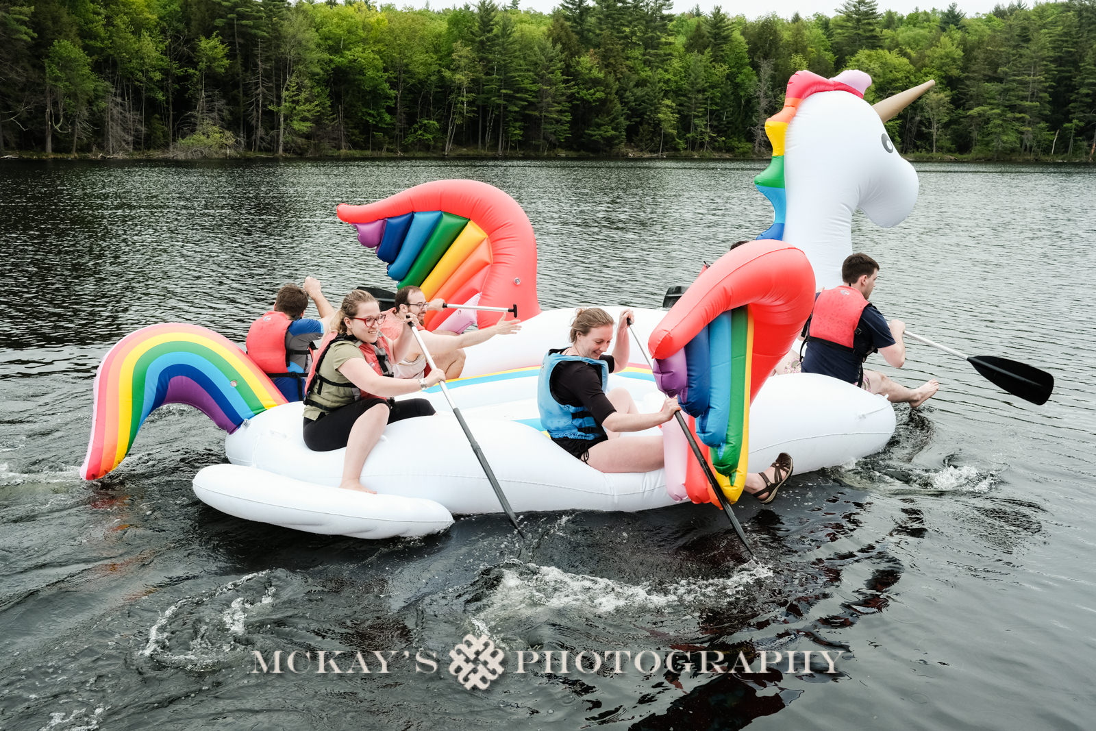 rainbow unicorn float in a lake